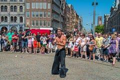 水坝正方形的街道演员 免版税库存照片