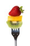水多叉子的新鲜水果 免版税库存照片