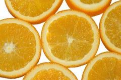 水多和新鲜的桔子果子被切成圆的圆环 顶视图 背景查出的白色 免版税库存照片