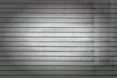 水平线背景  深灰墙壁由异常的条纹,板条做成 与小插图的照片 图库摄影