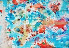 水彩橙色蓝色五颜六色的形状和闪耀的光,抽象背景 免版税图库摄影