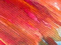 水彩艺术背景摘要温暖的秋天五颜六色的织地不很细红色橙色冲程 免版税库存照片