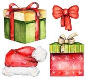 水彩设置了与两把礼物盒、圣诞老人帽子和弓 库存图片