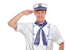 水手向致敬的年轻人 库存照片