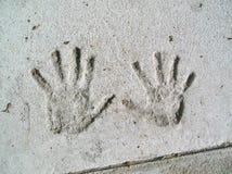 水泥handprints 库存图片