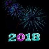 水色和紫色烟花2018年 免版税库存照片