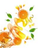 汁液橙色飞溅 免版税库存照片