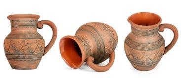 汇集在白色从不同的角度的黏土水罐隔绝的 免版税库存照片