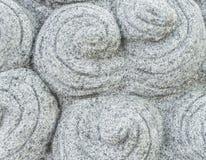 汉语与圆的蜗牛样式的被雕刻的灰色石头 免版税库存照片