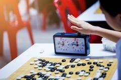 汉语去与读秒时钟的比赛战斗的 库存照片