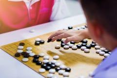 汉语去与读秒时钟的比赛战斗的 图库摄影