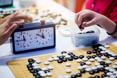 汉语去与读秒时钟的比赛战斗的 免版税库存照片