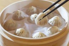 汉语蒸的猪肉小圆面包 库存图片