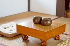 汉语,日本,韩国棋去 是或韦池氏- WeiQi传统亚洲棋 空是比赛板 库存图片