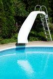 池幻灯片游泳 库存照片