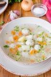 汤用鸡丸子和面条 免版税库存照片