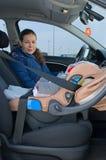 汽车儿童母亲安全性位子 免版税库存图片