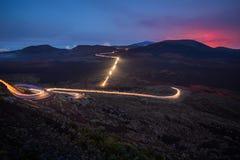 汽车光足迹在La Plaine des黑貂的在雷乌尼翁冰岛 库存图片