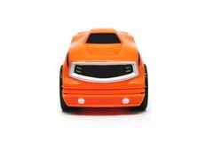 汽车前橙色种族玩具 免版税图库摄影