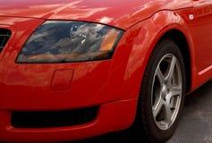 汽车前灯红色体育运动 免版税图库摄影