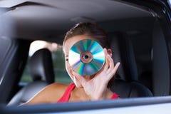 汽车司机女性音乐使用 免版税图库摄影