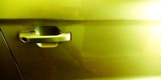 汽车在金黄颜色储蓄照片的边门锁 免版税图库摄影