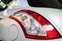 汽车尾灯和汽油箱盖子 免版税库存照片