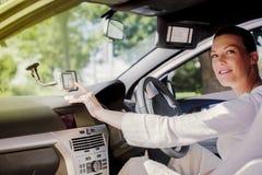 汽车愉快的妇女 免版税库存图片