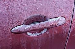 冻汽车把柄 免版税库存图片