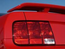 汽车新的红色尾灯 免版税库存图片