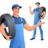 汽车机械师汽车服务人藏品轮胎 r 免版税库存照片