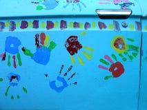 汽车特写镜头门handprints 库存照片