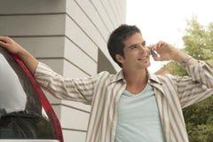 汽车电池家庭倾斜的人电话技术 免版税库存图片