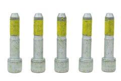 汽车的五个螺栓有在线程数的黄色胶浆的 免版税库存照片