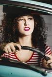 汽车的美丽的妇女 库存图片