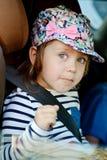 汽车的滑稽的女孩 免版税库存照片