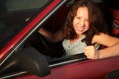 汽车红色妇女 免版税库存照片