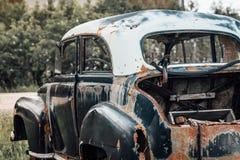 汽车老生锈的击毁 库存图片