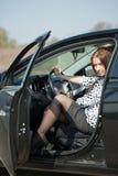汽车获得妇女 库存图片