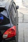 汽车表面上的雨珠 免版税库存照片