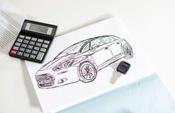 汽车设计、钥匙和计算器 免版税库存图片