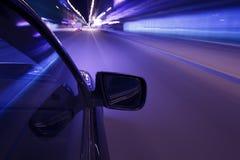 汽车速度夜驱动 图库摄影