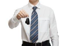 给汽车钥匙的商人 免版税库存图片