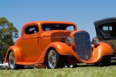 汽车马力强大的橙色汽车 图库摄影