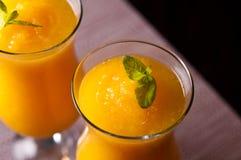汽酒和橙汁与冰喝 免版税库存照片