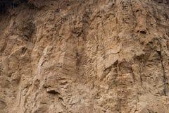 沃土的山沟墙壁的特写镜头作为环境纹理背景 免版税库存照片