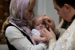 沃洛格达州,俄罗斯- 2015年12月25日:突然显现婴孩仪式  免版税库存图片