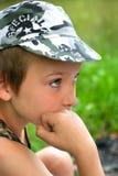 沉思的男孩 免版税图库摄影