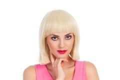 沉思美丽的白肤金发的女孩 免版税库存图片