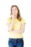 沉思年轻学生妇女照片  免版税图库摄影